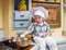 Stock Image : Little boy  plays the cook
