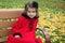 Stock Image : Little Girl in Autumn Park