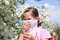 Stock Image : Little girl is blowing her nose