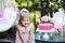 Stock Image : Little girl celebrate Happy Birthday Party with rose outdoor