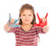Stock Image : Little Girl Playing with Paint doing the horns.
