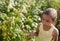 Stock Image : Little girl  and raspberries