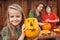 Stock Image : Little girl showing her Halloween jack-o-lantern