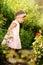 Stock Image : Little Girl Standing in a Garden