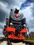Locomotive. Old locomotive traveling by rail. Shot by cell phone