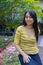 Stock Image : Long balck hair asian girl in the garden