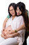 Stock Image : Lovely pregnant with her yonger sister used hand  touched torso