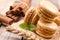 Stock Image : Macaroons with cinnamon sticks