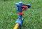 Stock Image : Macro sprinkler off on green lawn