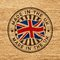 Stock Image : Made in the UK. Stamp on wooden background