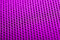 Stock Image : Magenta background. Mesh fabric texture. Macro