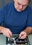 Stock Image : The man repairing DVD a player