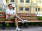Stock Image : Man sitting waiting on an urban bench