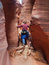 Stock Image : Man walking down narrow canyon