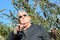 Stock Image : Man wearing sun glasses pointing.