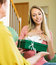 Stock Image : Mature mother presenting gift in box to  daughter