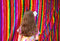 Stock Image : Mexican multicolor fabric and girl