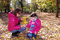 Stock Image : Mom and daughter collect autumn leaves