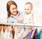Stock Image : Mom and  little daughter choosing dress