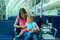 Stock Image : Mother and baby waiting in the airport