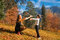 Stock Image : Mother and son playing in autumn