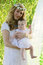 Stock Image : Mother with wreath holding baby girl