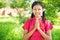 Myanmar girl in welcoming pose at outdoor.