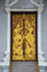 Stock Image : Native Thai style carving, painting on church door in Thai templ