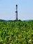 Stock Image : Natural Gas Drill Rising Out of Cornfield