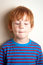 Stock Image : Naughty looking boy