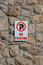 Stock Image : No Parking Sign on Stone Wall