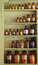 Stock Image : Old apothecary cabinet with storage jars