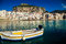 Stock Image : Old boat drifting in a Cefalu harbor