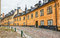 Stock Image : Old street with yellow buildings in Stockholm.