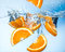 Orange fruits fall deeply under water with splash