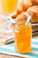 Stock Image : Orange jam with juice and croissants.