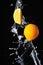 Stock Image : Orange with splash on a black