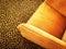 Stock Image : Orange velvet armchair on leopard carpet