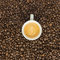 Stock Image : Overhead view of espresso coffee on beans