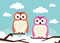 Stock Image : 2 owls on branches