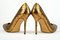 Stock Image : Pair of golden colored High Heel