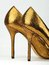 Stock Image : Pair of golden colored High Heels