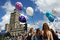 Stock Image : Palace of science and culture in Warsaw and girls with baloons