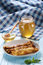 Stock Image : Pancakes with honey on a plate, the honey in a glass bowl