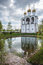 Stock Image : Peaceful and quiet view of the belfry, reflected in a lake