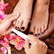 Stock Image : Pedicurist master makes pedicure on woman's legs