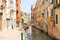 Stock Image : People near picturesque bridge over a narrow canal in Venice, It