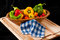 Stock Image : Peppers on Cutting Board