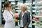 Stock Image : Pharmacist and grateful senior woman