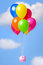 Stock Image : Piggy Bank floating through the sky on balloons